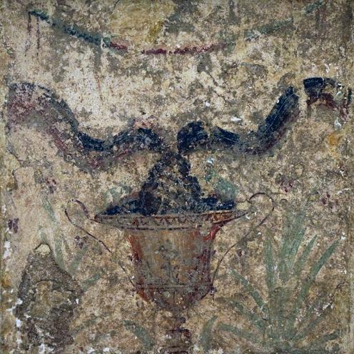 Representación figurativa: copa, piña y serpientes. Atributos de Esculapio.